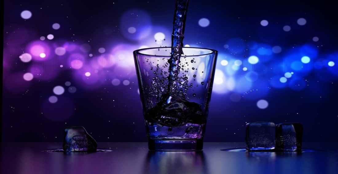 close up of water splashing in drinking glass